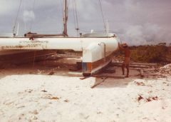 image of Stratosphere after it have been towed on land with an old bedford truck on rafts underneeth the hull
